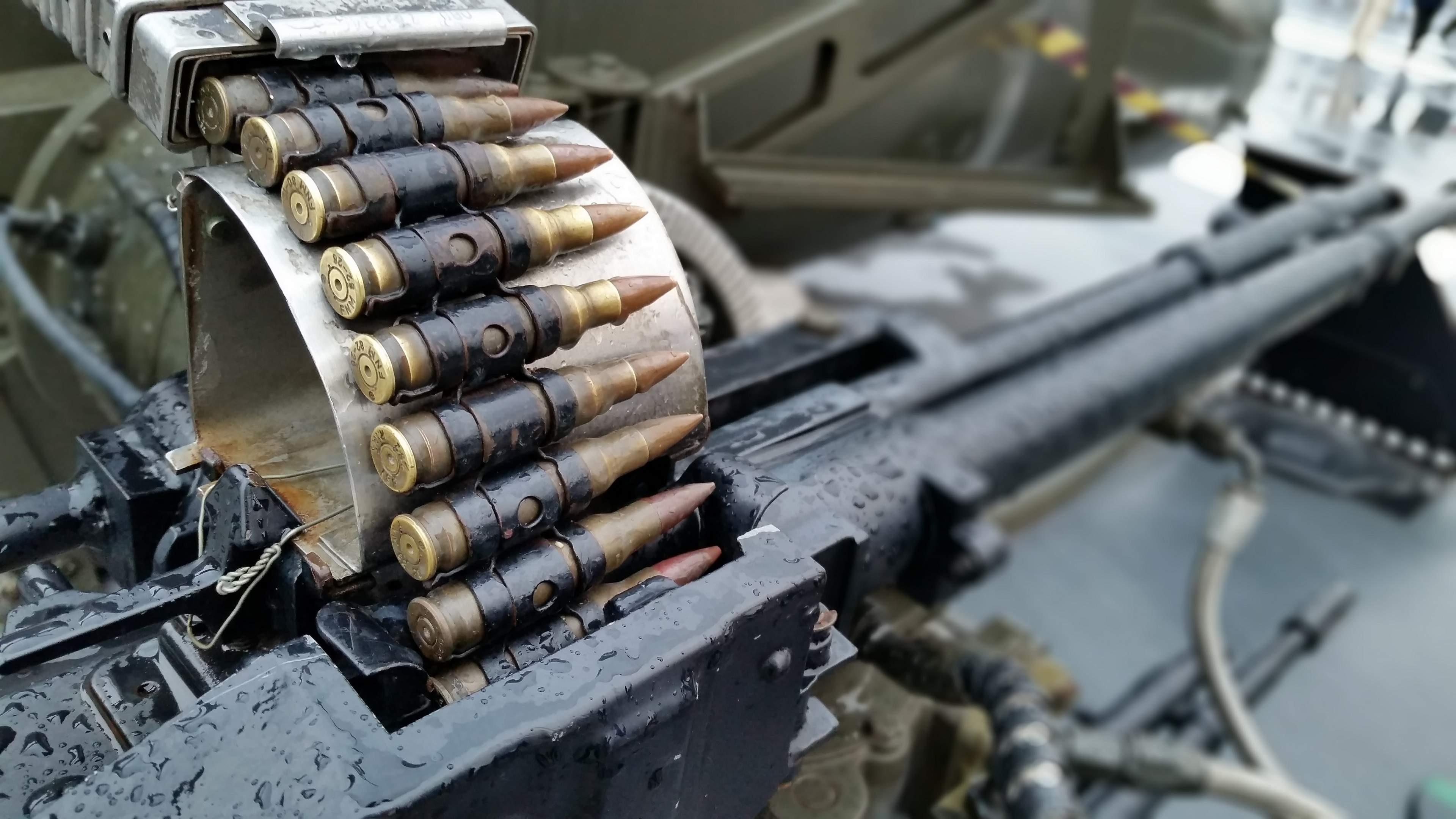 Army Arsenal Machine Gun And Bullets 4k Wallpaper Ultra Hd