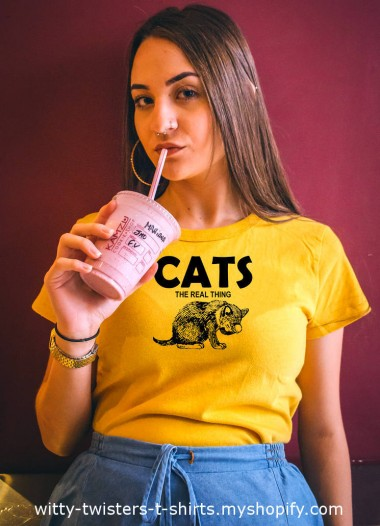 Do you like the new CATS movie or the stage musical? Or do you prefer the real thing instead? The musical was great, and the movie is getting huge reactions, but if you're a cat person, you know the real thing is always better anyway.  Purchase this CATS t-shirt here:  https://witty-twisters-t-shirts.myshopify.com/search?q=Cats+-+The+Real+Thing