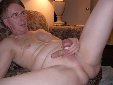 Nude lying on the sofa fully shaved and totally exposed while wearing ball rings.