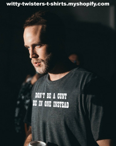 """The word """"cunt"""" spiked in British English in 1961 and Billy Butcher (Karl Urban) on The Boys TV show says it all the time. On this witty t-shirt, both UK and US versions of cunt are used at the same time. Wear this funny t-shirt and don't be a cunt.  Buy this funny cunt t-shirt for men or women here:  https://witty-twisters-t-shirts.myshopify.com/search?q=Don%27t+Be+A+Cunt+-+Be+In+One+Instead"""